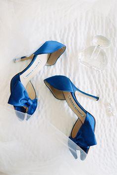Blue Manolo Blahnik wedding shoes | @cocotranphoto | Brides.com