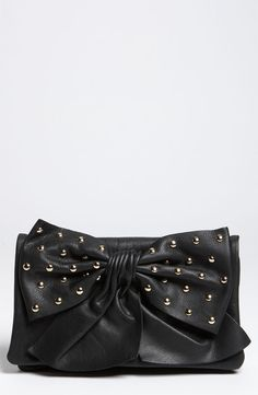 Red Valentino black leather studded bow clutch with a gold chain strap that can be brought out for a daytime crossover.