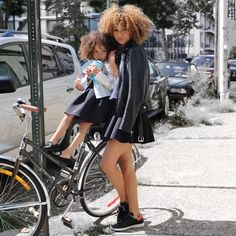 Beautiful Mommy and daughter in same   street fashion