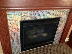 Shimmery glass mosaic tile fireplace surround!