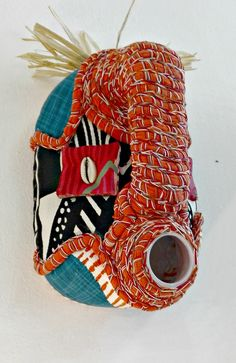 contemporary take on the African mask, 5 l plastic container upholstered with hand painted textile, crocheted braids made in Cape Town African Masks, African Jewelry, Crochet Braids, Cape Town, Craft Stores, Textile Art, Artsy Fartsy, Jewelry Crafts, Container