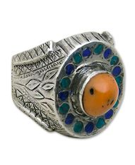 Afghanistan | sterling Silver and Coral | Interesting silver ring of Afghan handicrafts with a peculiar design.  The frame is decorated on both sides with . ..