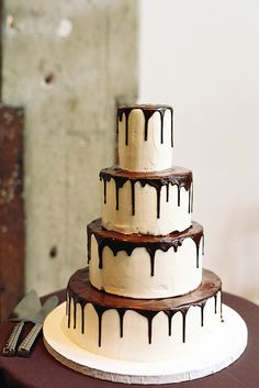 Wedding cake with chocolate sauce drizzle. 10 Tempting Chocolate Wedding Cakes on @intimatewedding #cake #chocolatecake #weddingcake