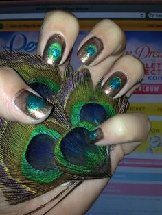 my submission for Katy Perry Inspired style..... Peacock nails!! tumara