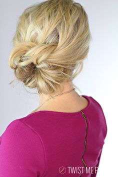 Elegant Knotted Updo...this look will vary depending on your hair texture.... have fun with it....