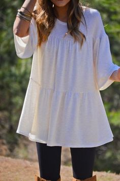 The juniper tunic is a oatmeal neutral color with flare and long over-sized sleeves. The chic and comfortable look is a style that anyone can pull off! $34.00