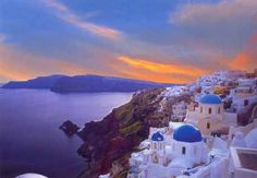 I have to go to the Greek Isles! The white buildings with the blue roofs on the side of a cliff are just breath taking!