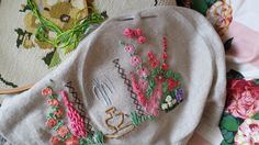 working progress cottage court yard with water fountain embroidery i'm currently working on