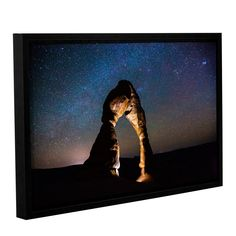ArtWall Cody York's 'Delicate Arch Under The Stars' Gallery Wrapped Floater-framed Canvas (12x18), Brown