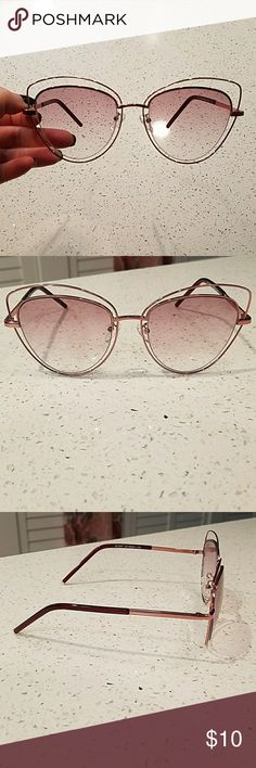 Wire Rim Cat Eye Sunglasses NWOT Rose toned sunglasses with metal frame. Non-polarized. I purchased these for a trip to Mexico but never wore them and then waited too long to return. Accessories Glasses