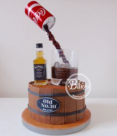 BuBakes gravity defying Jack Daniels and Coke cake www.bubakes.co.uk Liquor Cake, Coke Cake, Anti Gravity Cake, Gravity Defying Cake, Birthday Cakes For Men, Jack Daniels Torte, Barrel Cake, Bottle Cake, Novelty Cakes