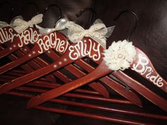 custom painted hangers for bridesmaids, bridesmaids gifts, wedding party gifts, flower girls. $12.00, via Etsy.