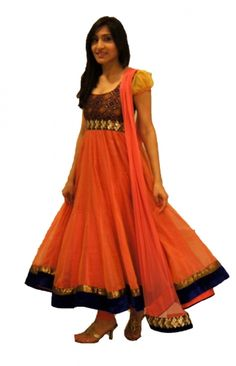 Beautiful orange-peach anarkali with brocade body and yellow sleeves embroidered with antique and gold borders and royal blue velvet trimmings.