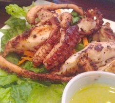 At Dafni Greek Restaurant ...the grilled octopus, octapodi ($12.95), came  accompanied by salad with lemon dressing.