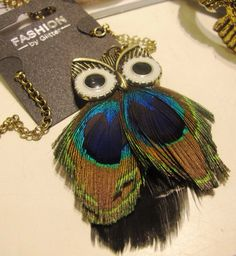 Owls with peacock feathers?                        Adorable yet confusing.