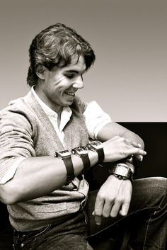 Nadal with his almost 5 million dollars worth of Richard Mille watches..Casual.