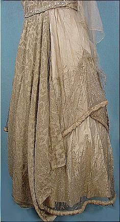 c. 1917 Evening Gown of Ivory and Platinum/Gold Metallic Brocade with Embroidered Net and Crystal Beading. Detail