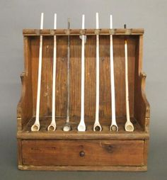 A century American Pine hanging pipe box. Squared back with hanging hole, shaped sides notched for seven pipes over a lower dovetailed drawer. Older finish with some wear, lacks front rail abov. Antique Pine Furniture, Art Furniture, Furniture Plans, Wall Cupboards, Wall Shelves, Clay Pipes, Pipes And Cigars, Wall Boxes, Primitive Antiques