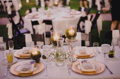 Gold wedding table setting. Tacoma Wedding © Ryan Flynn Photography. www.ryanflynnphotography.net. Read more - http://www.stylemepretty.com/2012/01/25/tacoma-wedding-by-ryan-flynn-photography/