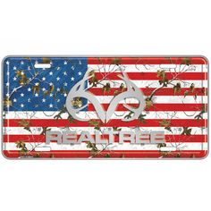 "This decorative sign measures 12"""" x 6"""" and is made of high quality, sturdy aluminum metal. This Fashion Plate has Realtree Xtra Camo Colors as the American Flag Background with Realtree and the Antl"