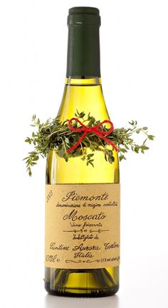 Put a herb wreath around bottle with a bow.  Alternative idea from simply a bow.