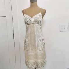 Bcbg maxazria silk dress Bcbg silk dress. Fully lined with side zip and adjustable cami straps. Great condition. Cream with tiny navy squares. Beautiful lace detail BCBGMaxAzria Dresses
