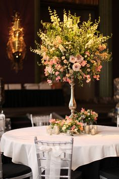 Elevated garden centerpiece in the Continental Room at the Hilton Netherland Plaza Hotel, by Cincinnati wedding florist Floral Verde LLC.