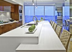 White counter tops and Modern Kitchen cabinets in wood lacquer from Warmington & North via Houzz.com