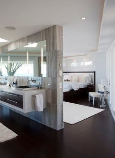 If you prefer a more open type of design, you can have a partial wall separating the bathroom from the bedroom