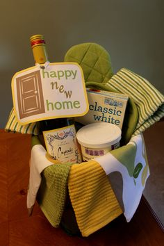 Housewarming gift idea- my first pin that I actually made! Inside basket is several dishtowels, 3 potholders, Cupcake wine, cake mix, frosting, and cupcake wrappers.