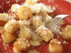 "This ""gnocchi"" sounds INCREDIBLE.  The video is wonderful-- 3 pounds of potatoes- baked, then scooped from peels, then refrigerated, 2 cups of flour, 1 cup of parmesan.  Add salt & pepper to taste.  Then mix, mix, mix... keep mixing until it all gets acquainted.  Then roll out, cut into 1-in cubes.  Sautee butter, garlic head chopped, and red peppers.  Boil gnocci a little bit like pasta, and then plop in with the butter & garlic.  Oh my goodness, this looks incredible. Coat in parmesan…"