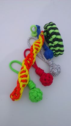 New knots and weavings in my experience. New order of my friend. Wrapture key fob in orange and yellow, 4 tiny globe knots in neon green, red, arctic camp and royal blue colors, fistail bracelet in black an neon lime colors #wrapture #fishtail #tinyGlobeKnot #bracelet #keychain #leyton #zippullers #handmade #instaparacord #gear #paracord #paracord550 #instaparacord #instahandmade