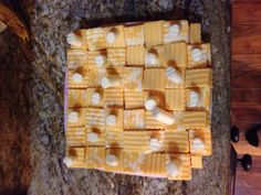 Chess board made from cheeses. Checkmate chess club