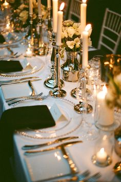 wedding table design with simple candles, black and white linen and silver rimmed charger plates. Like the contrast of the black. LMC