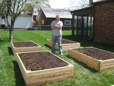 Raised bed with 4x4 posts and 2x4's on the exterior.