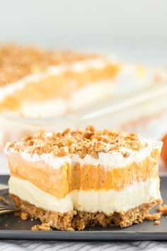 Instead of pumpkin pie, try this easy pumpkin delight recipe instead! A homemade pecan and graham cracker mix forms a delicious crust that is topped with three layers of light and fluffy filling -- including cream cheese, pumpkin, pudding and Cool Whip. Pumpkin Delight Dessert Recipe, Pumpkin Dessert, Pumpkin Cheesecake, Dessert Recipes, Cheesecake Bars, Pie Recipes, Fall Recipes, Delicious Desserts, Savory Pumpkin Recipes