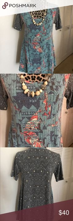 Lularoe Perfect T New with tag attached Lularoe Perfect T in size xxs. Tops Tunics