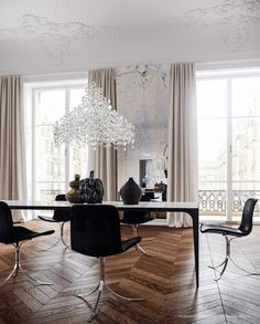 Paris apartment, interior design by Jessica Vedel: Poul Kjærholm PK9 dining chairs, 1960, and unique vases by Axel Salto, ca.1950-1960s for ...