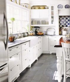 White Kitchen Grey Floor creamy white cabinets paired with supreme white quartzite