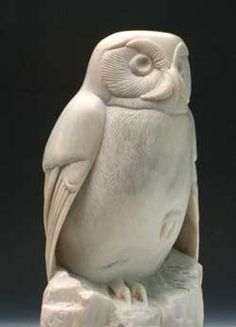 Stare Down, a Soapstone Owl created by Clarence P. Cameron of Madison, Wisconsin. This one is East Indian soapstone.