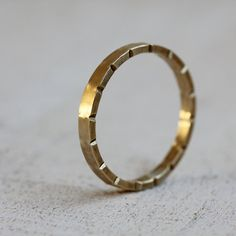 Gold wedding ring unique notched 14k solid gold wedding band from Praxis Jewelry