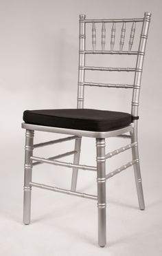 Silver Chiavari Chair frame by Vision Furniture. Featuring black cushion with Velcro.