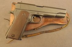 WW2 Colt 1911A1 Pistol with Holster Built in 1944Loading that magazine is a pain! Get your Magazine speedloader today! http://www.amazon.com/shops/raeind