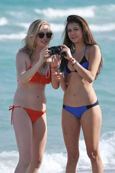 Vampire Diaries stars Candice Accola and Nina Dobrev hit South Beach and play with their Canon Powershot camera before the New Year's eve celebrations in Miami, Florida.