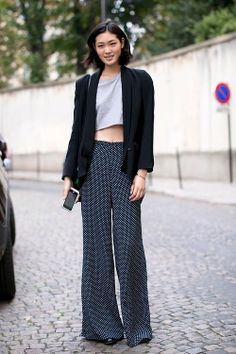 Shop this look for $113:  http://lookastic.com/women/looks/cropped-top-and-blazer-and-wide-leg-pants-and-heels-and-crossbody-bag/2322  — Grey Cropped Top  — Black Blazer  — Black Polka Dot Wide Leg Pants  — Black Leather Heels  — Dark Green Leather Crossbody Bag