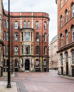 Side street with exposed brick buildings in Nottingham, England #nottingham #england #travel #uk #exposedbrickwalls