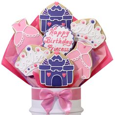 Make sure her birthday has a fairy tale ending with a gift only worthy of a princess. She will love this enchanted cookie bouquet including a hand-decorated castle, pretty pink dress and a bedazzled crown, made with our signature shortbread recipe. Let her know she is the fairest of them all with a personalized center cookie message. 5 and 7 piece available.