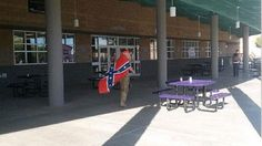 A student wears a Confederate flag.
