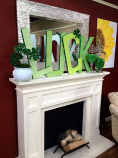 @Ken Vega Wingard decorates our mantel for St. Patrick's Day with cutout letters and glittery #shamrocks! #HomeandFamily #HomeandFamilyTV #StPatricksDay #glitter #decor #FireplaceMantel