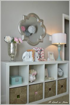 Need storage? This Expedit from IKEA has maximum storage and design appeal!...mirror idea